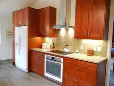 Wood Cabinets And White Countertops Google Search Kitchens - Medium brown kitchen cabinets