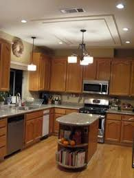 Fluorescent Kitchen Lights by How To Paint Your Kitchen Cabinets Without Losing Your Mind