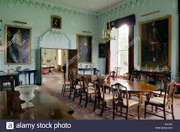 dining room with oil paintings and double door in 17th century