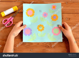 child holds card flowers his hands stock photo 418504915