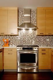 kitchen range backsplash how high do you hang a range hood