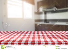 Kitchen Background Empty Table With Tablecloth And Blurred Kitchen Background