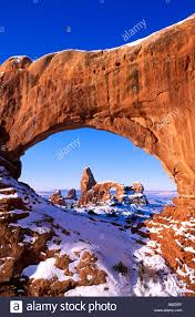 morning light on north window framing turret arch in winter arches