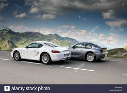 porsche cayman white porsche cayman model year 2006 white overtakes a bmw z4 3 0si