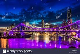 vibrant time panorama of brisbane city with purple lights on