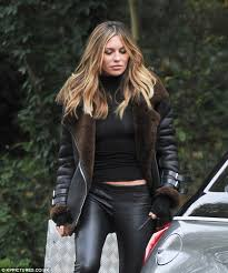 car commercial girl short blond hair abbey clancy displays her svelte physique in racy leather leggings