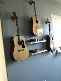 How To Hang Pictures On A Wall How To Hang Guitar On Wall Wall Art Design