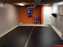 customer thomas zupanci installs his new home wrestling mat