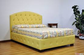 french bed with curved headboard and buttoned base