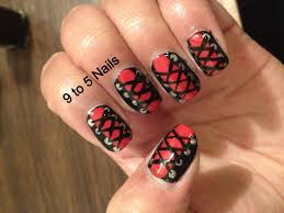 red and black corset nail art design