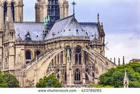 flying buttress flying buttresses spires towers overcast skies stock photo