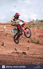 motocross race riders getting airborne during a motocross race stock photo