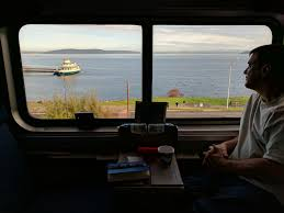 amtrak coast starlight from san jose to seattle the holle days brian holle looking out the window from her superliner bedroom on the coast starlight
