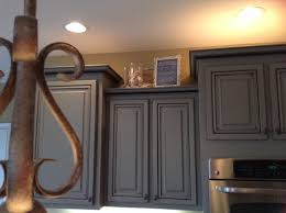 How To Decorate Above Cabinets Help Is Above Kitchen Cabinet Decorating Outdated