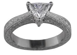 engraving engagement ring trilliant diamond set in an engraved platinum ring bijoux
