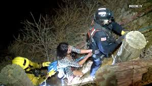 couple rescued by after falling off cliff into ravine in