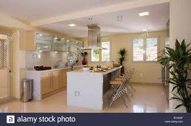 marble floor in modern kitchen with illuminated wall cupboards and
