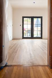 install base cabinets before flooring installing new hardwood floors in our home the gold hive