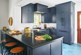 two tone kitchen cabinets with black countertops 5 countertops that look beautiful in a blue kitchen