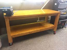 how to build a sturdy workbench inexpensively 5 steps with pictures just finished with a coat of deck stain and polyurethane added some wheels as an added touch to move around the garage as needed