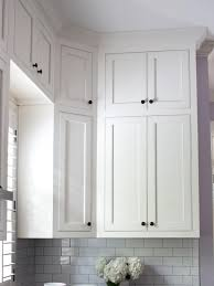 how to make cabinets appear taller white cupboards and subway tile kitchen cabinets to