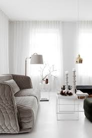 white livingroom furniture expert advice 11 tips for a room look bigger remodelista