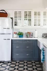 vintage kitchen tile backsplash white refrigerator blue grey kitchen cabinet cast iron kitchen
