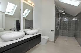sink vanity lighting over mirror wood master bathroom clear glass