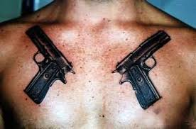 showing small gun tattoo on chest photo 2 photo pictures and