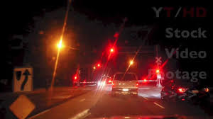 railroad crossing lights blinking w arms going up for