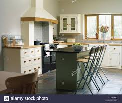 kitchen islands breakfast bar central island breakfast bar in kitchen with fitted units stock