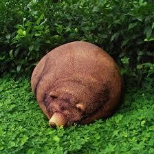 a freaky and real looking sleeping grizzly bear bean bag