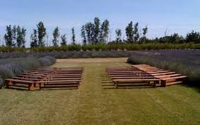 Farm Benches - lavender field wedding ceremony wooden benches set up theater