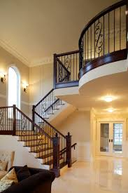the large landing at the top of the stairs pushes out over the