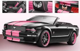 a pink mustang black convertable mustang with pink racing stripes so my