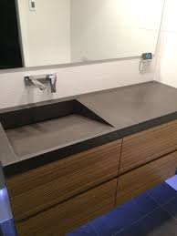 polished concrete vanity top with integrated sink by mitchell bink