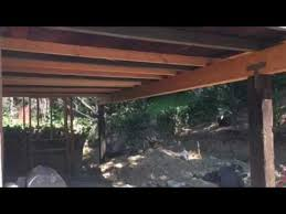 installation of a header beam for a patio overhang by crown