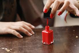 file red nail polish in application jpg wikimedia commons