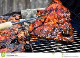 barbecued bar b q on backyard grill royalty free stock photo
