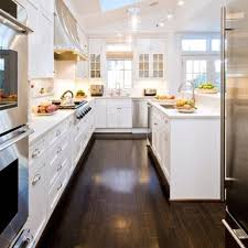 brown granite countertops with white cabinets black sink and black curved faucet beige tile ceramic flooring wood