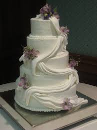 delectable sweets by the smiths draped wedding cake