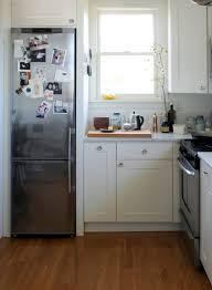 kitchen room refrigerator wood panels undercounter freezer