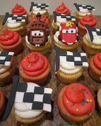 mater and lightning mcqueen were sculpted from fondant and the checd flags were also made from fondant happy birthday