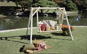 rustic log frame outdoor swings and gliders