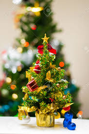 Office Table Christmas Decoration by Mini Christmas Tree On Office Desk Stock Photo Picture And
