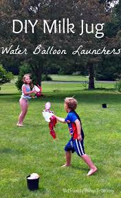 Kids Outdoor Entertainment - diy milk jug water balloon launch outdoor summer game for kids