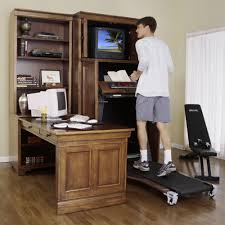 Computer Cabinet Armoire by The Treadmill Armoire Cabinet Hammacher Schlemmer