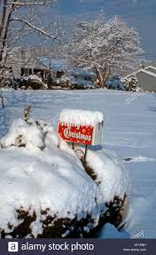 merry banner on a snow covered mailbox in suburban usa in