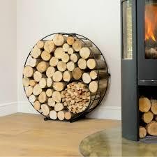 circular round metal log and kindling holder log carrier logs