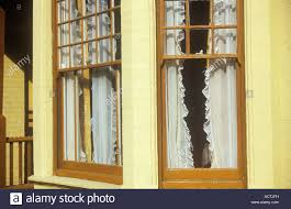 bow fronted window stock photos bow fronted window stock images bay sash windows and porch of edwardian terrace villa house with frilly net curtains and painted